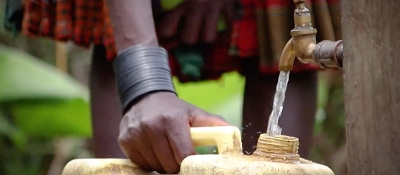 Clean water well filling a bucket